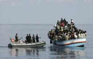 Italian coastguards intercept a boatload of illegal migrants