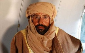 Saif Al-Islam shortly after his capture disguised as a Tuareg (File photo)