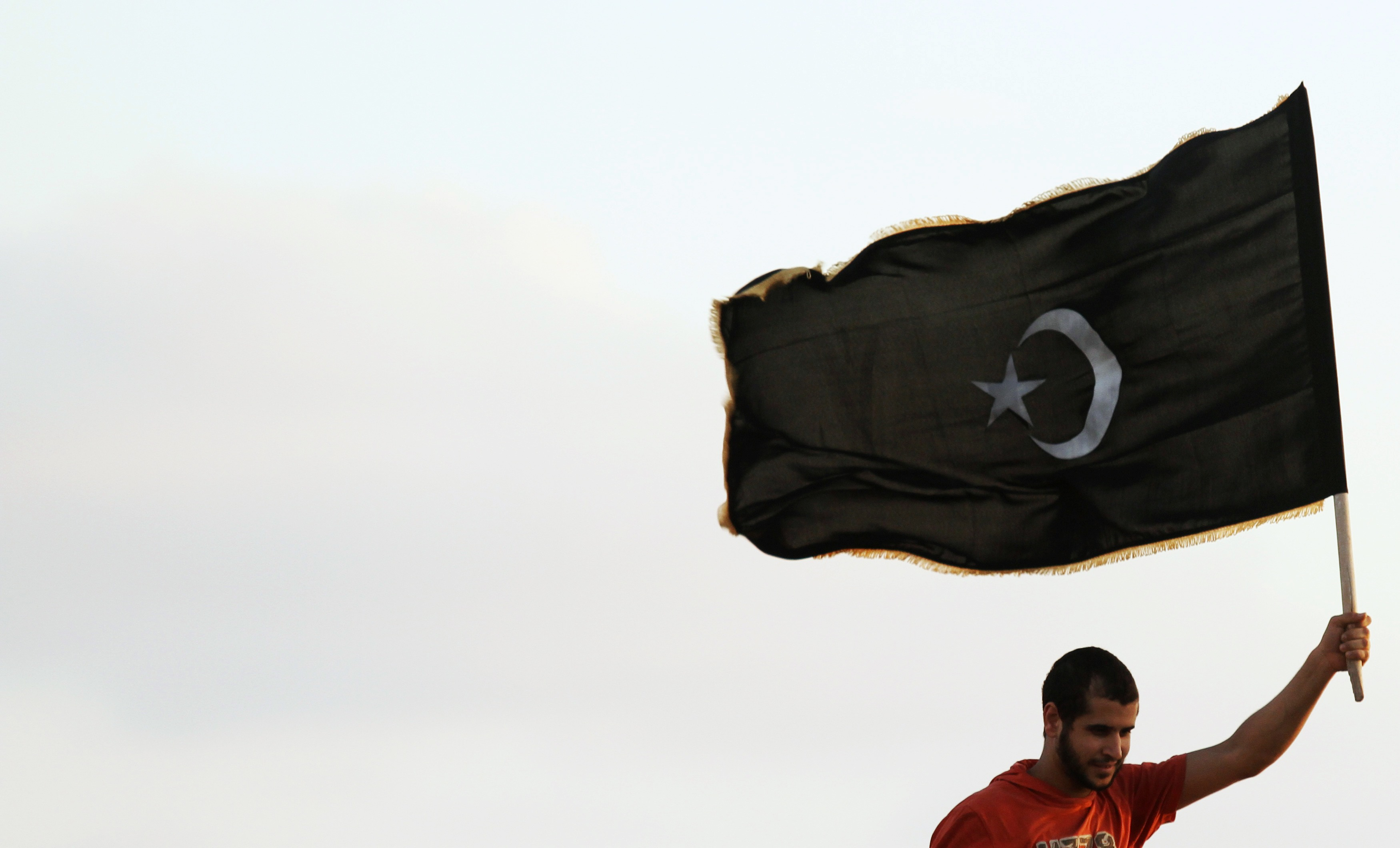 A Protester Waves The Black Flag Of Cyrenaica During A Pro Federalism Rally In Benghazi
