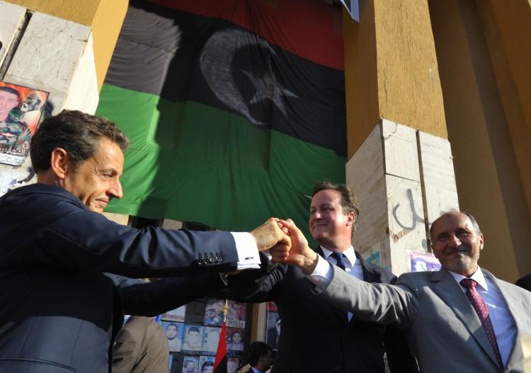 Nicolas Sarkozy with UK Prime Minister David Cameron and former NTC leader Mustafa Abdul Jalil in Benghazi in November 2011