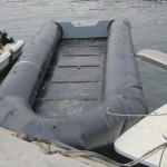 Coastguard retrieves empty migrant boat, suspects tragic end
