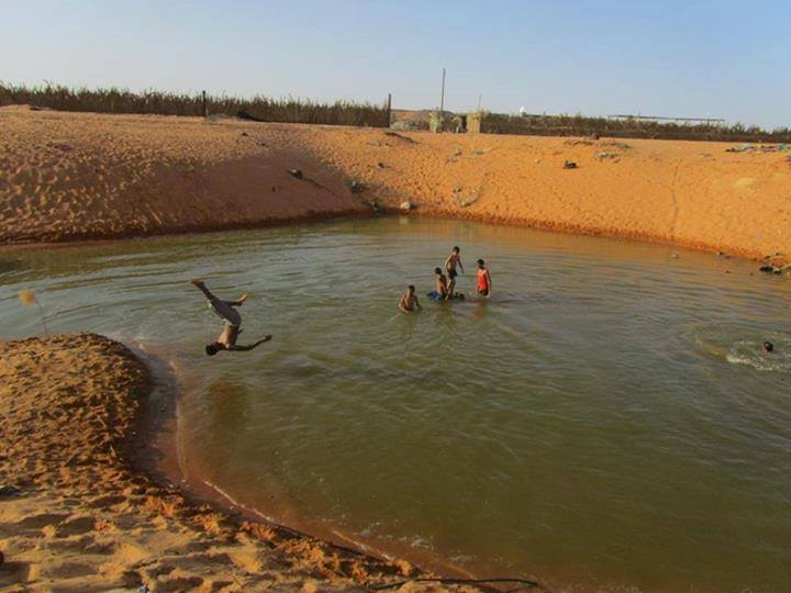 Locals Turn Disused Kufra Sand Quarry Into Swimming Pool