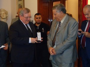 Greece's Ambassador in Tripoli, Kyriakos Amiridis presents Libyan Archaeology and Ancient Languages Dr Fadel Ali Mohamed was honoured with the Golden Order of the Phoenix (Photo: Sami Zaptia).