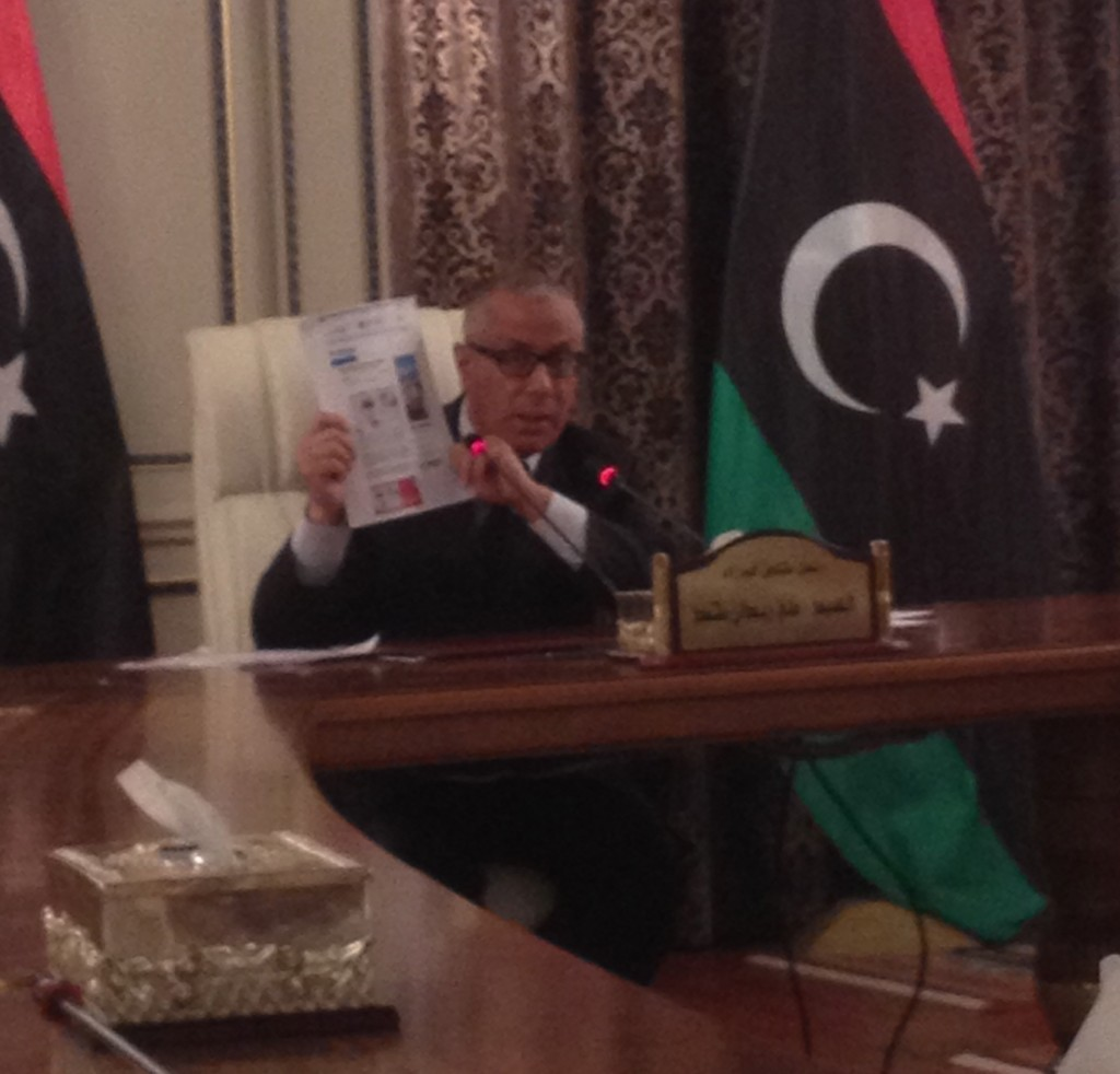 The Prime Minister shows copies of forged press reports that claimed he had given names of Libyan Islamists to the Americans