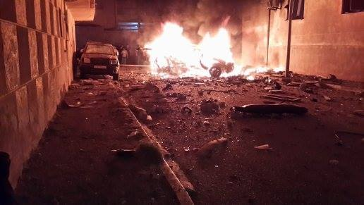 a bombed vehicle blazes in Derna this evening