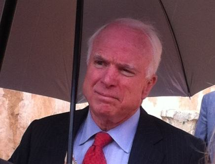 Senator John McCain sheltering from the rain this morning in Tripoli (Photo: Tom Westcott, Libya Herald)