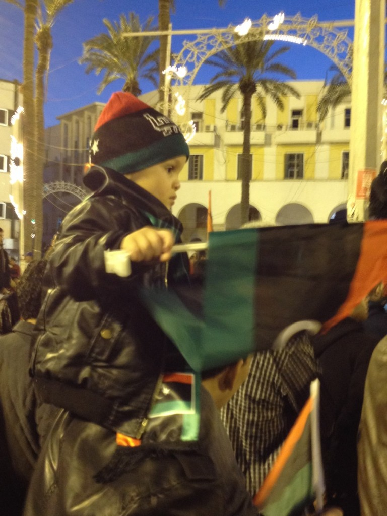 A small child waving a flag in Tripoli's Martyrs' Square last night (Photo: To Westcott)