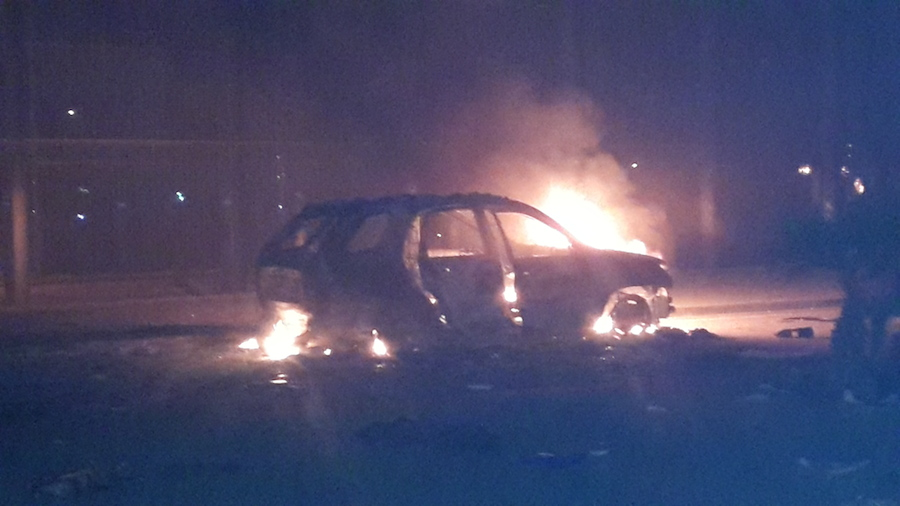 A burning car outside Congress this evening (Photo: Ahmed Elumami)