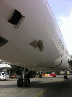 "A picture believed to show the ""written off"" A330, whose tail section was also riddled.(Picture: social media)"