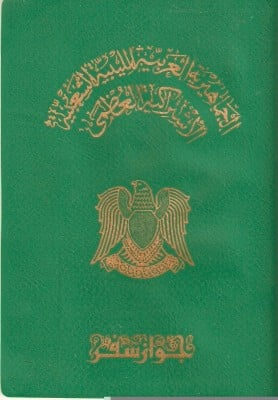The details of the old Qaddafi-era Libyan passports were written by hand.