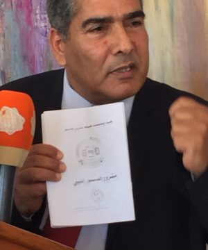CDA member Omar Mohamed Ali with the CDA's final draft (Photo: Libya Herald)