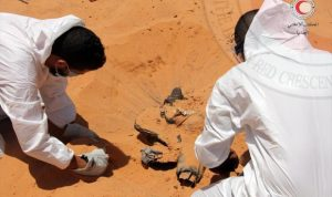 Libyan Red Crescent workers exhuming the mass grave (Photo: Red Crescent)