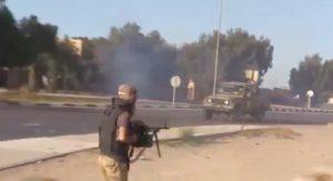 An exposed BM machine gunner firing from the hip (Photo:screen grab)