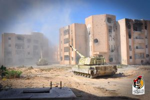 Two tanks, guns elevated move though the 600 apartment complex today (Photo: BM)