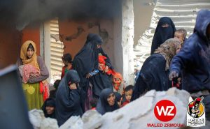 The fearful faces of defeat. Women with children flee over the rubble (Photo: