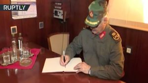 Khalifa Hafter signs a visitors book or an arms contract?