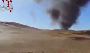 A screen grab showing the billowing smoke where the Mi-35 crashed