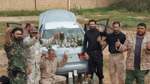 Triumphant LNA explosives team pose behind the car bomb after they had made it safe (Photo: Social media)
