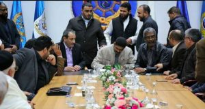 PC member Ahmed Hamza signs last night's shaky ceasefire (Photo: PC)