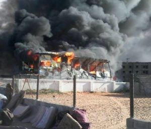 A pall of smoke over the Sidi Saih refugee camp today (Photo: Tawerghan Foundation)