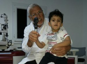 Dr Miloud Araoud with a young patient (Photo: supplied)