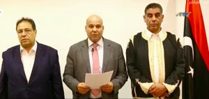 Majbri flanked by sombre Aswad (L) and Gatrani reads their statement (Image: Libyaschannel TV)
