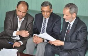 During a handover ceremony, Dr Nabil Alageli (centre) takes over as head of the TMC (Photo: TMC).