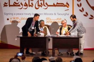 Tawergha and Misrata sign a peace deal paving the way for over 40,000 Tawerghans to return to their home town after a seven year absence (Photo: Signing Ceremony FB page).