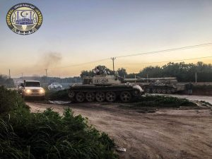 A tank belonging to the PC-aligned militia coalition, the TPF, in a field near Gaser Ben Ghashir during yesterday's south Tripoli militia fighting (Photo: TPF).