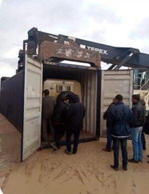 An armoured vehicle in a container seized by customs at Khoms port last week (Photo: Social media).